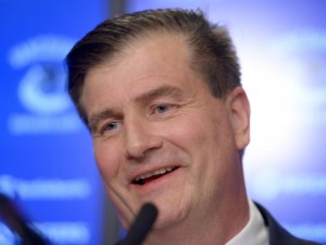 Jim Benning at the press conference Friday 23 May 14. Courtesy Jonathan Hayward - Canadian Press